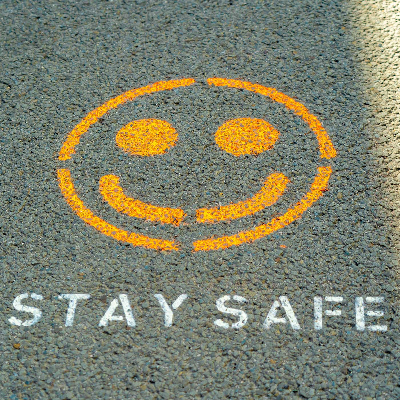 Stay safe message and smiley face image